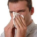 man sneezing - allergy treatments at silicon valley medical clinic